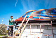 New roof. Roofer building a new roof of a house Royalty Free Stock Photos