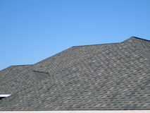 New Roof. A newly installed composition shingle roof on a bright sunny day Royalty Free Stock Photo
