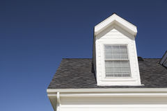 New Roof of House and Windows Against Deep Blue Sky Royalty Free Stock Images