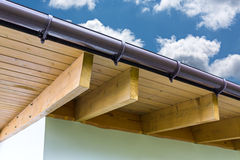 New roof and rain gutter Stock Photography