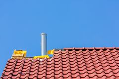New Roof With Roof Tiles And Chimney Pipe Stock Photo