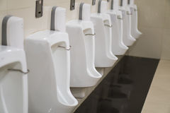 New row of outdoor urinals men public toilet Royalty Free Stock Photo