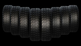 New rubber tires for car on black background. Royalty Free Stock Photos