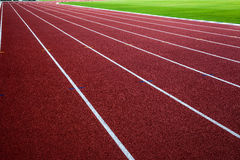 New running track with green grass, abstract, texture, background. Stock Photo