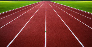 New running track with green grass abstract, texture, background. Royalty Free Stock Photo