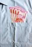 New 2000 rupee notes in an Indian mans shirts front pocket. Stock Images