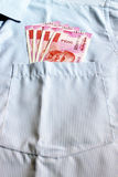 New 2000 rupee notes in an Indian mans shirts front pocket. Stock Image
