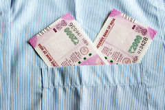 New 2000 rupee notes in an Indian mans shirts front pocket. Stock Photos