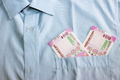 New 2000 rupee notes in an Indian mans shirts front pocket. Royalty Free Stock Photos