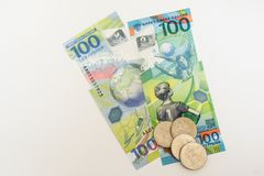 New Russian money issued specifically for the football championship. 100 and some coins with the symbol of the games wolf on a whi royalty free stock photo