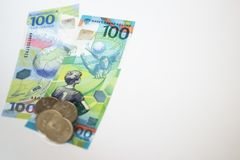 New Russian money issued specifically for the football championship. 100 and some coins with the symbol of the games wolf on a whi. Te background Stock Photos