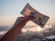 New russian 2000 rubles. New russian 2000 rubles in hand over city background Royalty Free Stock Photography