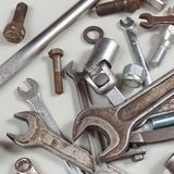 New and rusty metal tool for repairing machines closeup. New and rusty metal tool for repairing machines close up Royalty Free Stock Photos
