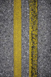 New and rusty yellow road lines Royalty Free Stock Photography