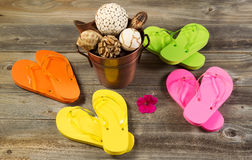 New Sandals with other spa items on rustic wood Royalty Free Stock Image