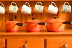 New saucepans on old dresser Royalty Free Stock Images