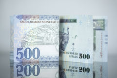 New Saudi Riyal notes vs Old one on a dark glass Stock Images