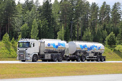 New Scania R500 Milk Tank Truck on Motorway at Summer. SALO, FINLAND - JUNE 19, 2016: Scania R500 Euro 6 tank truck transports Valio milk along motorway at stock images