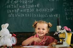 New scientific knowledge and technology. Primary school pupil note down scientific research on classroom chalkboard.  stock image