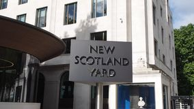 New Scotland Yard police sign in London stock video footage