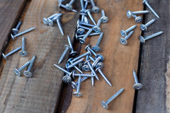 New screws on old wooden boards Royalty Free Stock Image