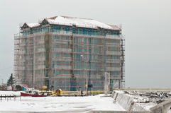 New seaside hotel under construction. Winter image of a new luxurious hotel being constructed at the port entrance. Location - Darlowo, Poland Royalty Free Stock Photography