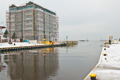 New seaside hotel under construction. Winter image of a new luxurious hotel being constructed at the port entrance. Location - Darlowo, Poland Stock Photos