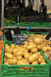 New season potatoes. Pomme de Terre (potatoes) for sale at the twice weekly street market La Ciotat Provence with people in the background. Copyspace Royalty Free Stock Photo
