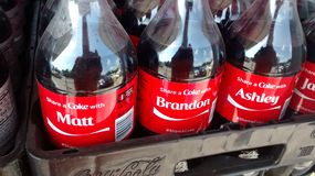 New share a coke. Bottles of coke with names on them Royalty Free Stock Images