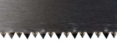 A new sharpened wood saw close-up. On white Royalty Free Stock Images