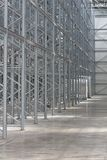 New Shelves Warehouse. Row of Empty Shelves in New Distribution Warehouse Royalty Free Stock Image