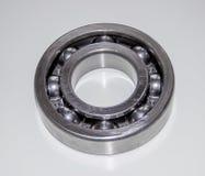 A new shiny ball bearing. Isolated on gray Stock Photo