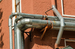 New shiny pipes outside facade of  house Royalty Free Stock Image