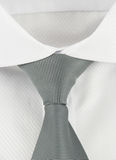 New shirt with a grey striped necktie Royalty Free Stock Photo