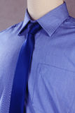 New shirt with necktie, studio shot. New blue shirt with necktie, studio shot Stock Images