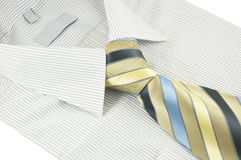 New shirt with striped necktie over white Stock Photos