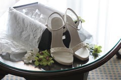 New Shoes. New white wedding shoes on table Stock Photos
