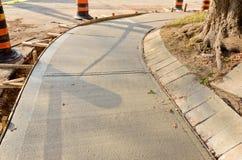 New Sidewalk. Freshly poured cement on sidewalk upgrade Royalty Free Stock Image