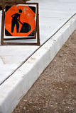 New sidewalks. Brand new sidewalk with focus on an orange construction worker sign Stock Photography