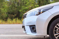 New silver car parking on the asphalt road Stock Image