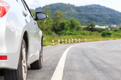 New silver car parking on the asphalt road Stock Images