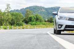 New silver car parking on the asphalt road Stock Photo