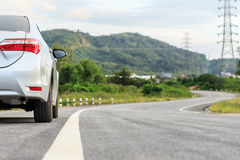 New silver car parking on the asphalt road Stock Photos