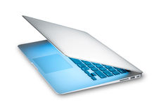New silver laptop in aluminum isolated on white. Modern silver aluminum laptop with blue light from screen isolated on white background. Popular thin computer stock photography