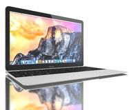 New Silver MacBook Air. New Silver MacBook displaying OS X Yosemite. The New MacBook is not only Apple's thinnest and lightest, but more functional and intuitive Royalty Free Stock Photography