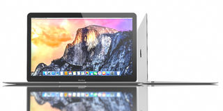 New Silver MacBook Air. New Silver MacBook displaying OS X Yosemite. The New MacBook is not only Apple's thinnest and lightest, but more functional and intuitive Stock Photography