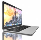 New Silver MacBook Air. New Silver MacBook displaying OS X Yosemite. The New MacBook is not only Apple's thinnest and lightest, but more functional and intuitive Royalty Free Stock Image
