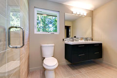 New simple modern bathroom with double sinks and natural ceramic tile. stock images