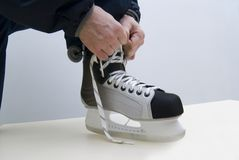 New skates. Try on new hockey a boot in shop Royalty Free Stock Photo