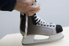 New skates. Try on new hockey a boot Royalty Free Stock Photo
